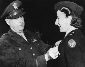 AVNURS, pho 1 Elsie Ott, who made the first air evacuation (?), was also the first to receive the Air Medal.  Shown in photo receiving the award from Brig Gen Fred W. Borum, who made the presentation at Bowman Field, KY, in 1943 (?). Credit Photo to the National Museum of the USAF