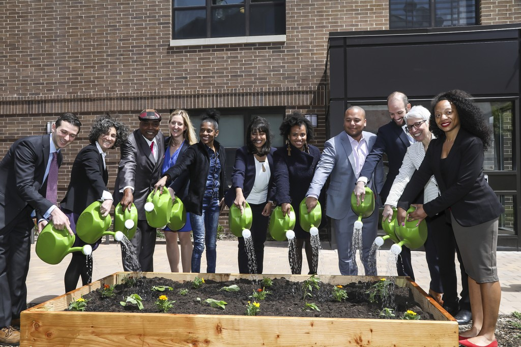 Partners commemorate the opening of the Henry Apartments in Brooklyn